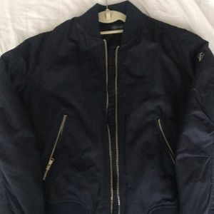 Worn once.  Navy gold zippers